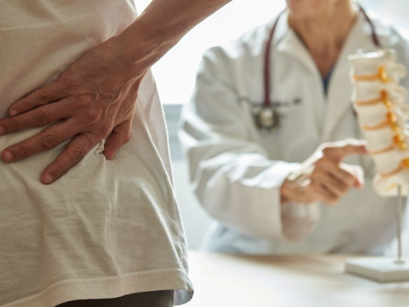 backpain patient visiting doctor in clinic