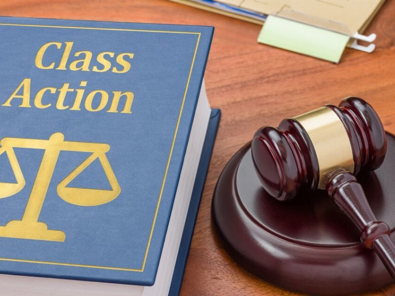 class action book with gavel McLachlan Law Firm