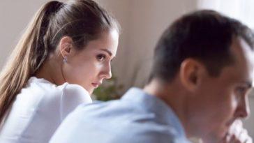 woman looking at husband suspiciously